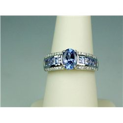 Terrific 14 karat white gold ladies ring set  with a combination of fine Tanzanite and  diamonds wei