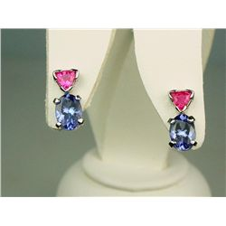 Elegant 14 karat yellow gold ladies handmade  earrings set with two matching oval blue  Tanzanites w
