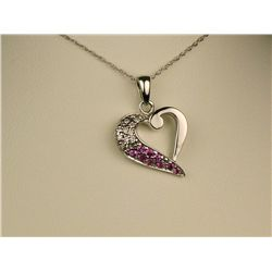 Pleasant 14 karat white gold ladies heart  design pendant pave set with round diamonds  and pink sap