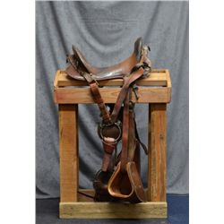 Authentic U.S. military McClellan saddle with  11 seat, wood stirrups with US- marked  leather cove