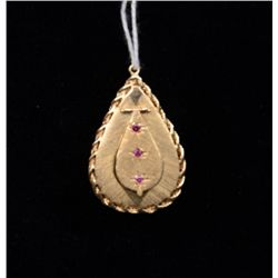 One unique antique handmade locket made in  14k yellow gold with hinged cover set with  rubies (wt 1
