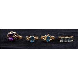 An assortment of 4 ladies rings in 14k yellow  gold set with amethyst, topaz and diamonds.   Total g