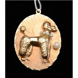 One custom designed 14k yellow gold poodle  pendant set with ruby eye and pearls.  Est.:   $425-$850