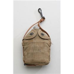 "U.S. military metal canteen with tan canvas  cover and leather carry strap stenciled ""US""  in overal"
