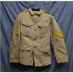 U.S. military tunic short jacket with brass  buttons and Sgt. Stripes on both sleeves; tan  color, y