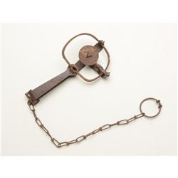Small iron animal trap with securing chain in  overall good uncleaned condition.  Est.:   $25-$50.