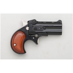 "Davis Model D-25 O/U derringer, .25 cal.,  2-1/2"" barrels, black finish, wood grips,  #188143. This"