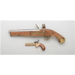 Lot of two black powder modern reproductions  including a large Tower-marked flintlock  pistol, .68