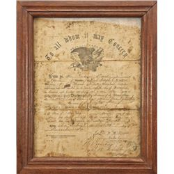 Framed discharge for Ludovica Davis, Private,  under Lt. Joseph E. Walker, Company D, first  regimen