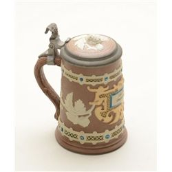 "Small German stein approx. 6"" in height and  approx. 3"" in diameter with multi-color  glazing and ar"