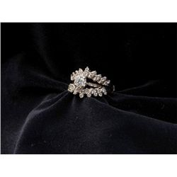 One diamond solitaire weighing approx 0.60ct  with a double diamond guard ring in 14k white  gold.