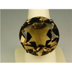 Sensational 14 karat very heavy yellow gold  ladies handmade ring set with a very large  round smoky