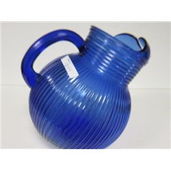 Blue vertically ribbed tilt jug pitcher with ice lip