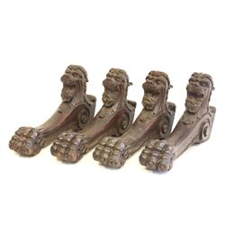 4 carved lion head legs from a dining room table