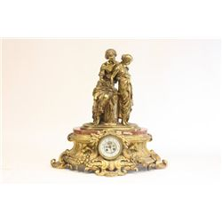19th c. bronze and marble figural clock