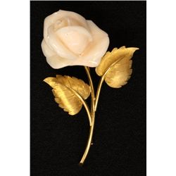 White coral rose on gold stem with leaves