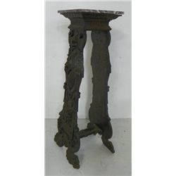 Carved oak plant stand by Cutler & Girard