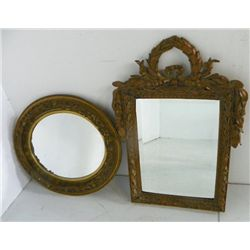 Oval mirror and ornate leaf design mirror