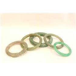 Group of 5 jade bangles