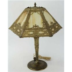 "Unmarked early table lamp with cast base and terrific caramel slag glass shade, 23"" tall."