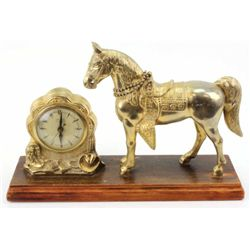 Vintage Horse Clock by United mounted on original wooden base and in working order at time of descri