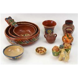 Collection of 10 Mexican pottery pieces including 1 set of hand painted nesting bowls, 1 donkey figu