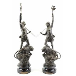 "Pair matching bronzes on turned wood basess entitled ""La Forge"" and ""Le Pouboir"", each 20"" tall."