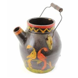 Early crock water pitcher with original hand decorated painted designs, wire bail and wood handle in