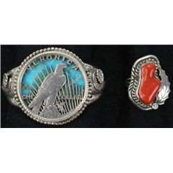Collection of 2 includes sterling silver and turquoise bracelet unsigned and sterling silver and red