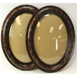"One pair antique picture frames oval with original bubble glass and finish, 25"" tall."