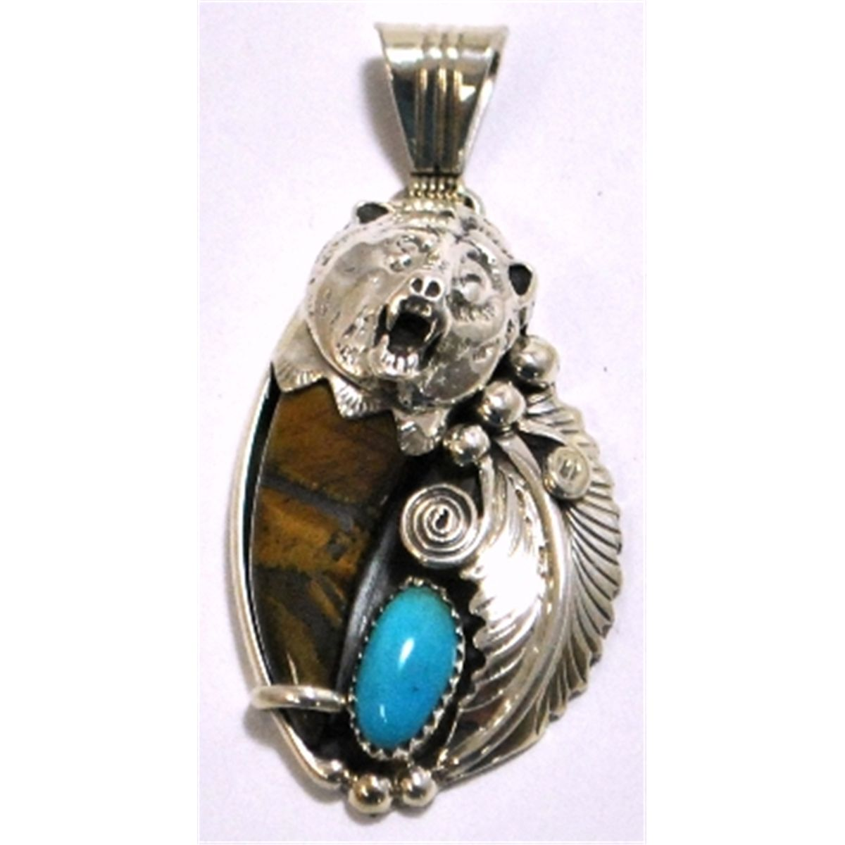 Navajo turquoise tigers eye claw sterling silver bear pendant rb aloadofball Choice Image