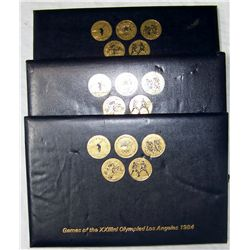 (3x$) RARE 1984 OLYMPIC TRANSIT COIN COLLECTIONS.