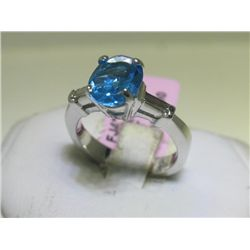 Blue Topaz and .16 Carat Diamonds 18K White Gold Ring