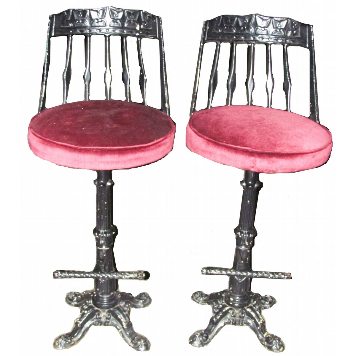 Two cast iron swivel bar stools