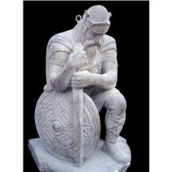 Ancient kneeling Norse warrior statue from Norwegian church