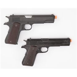Two (2) prop Colt .45 resin pistols