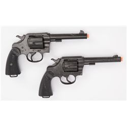 Two (2) prop Colt .45 six-shooters