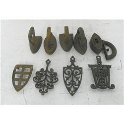 4 iron trivets & 4 irons