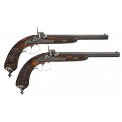 Pair of Gold Inlaid and Engraved J. Schenk Percussion Target Pistols with Relief Carved Stock