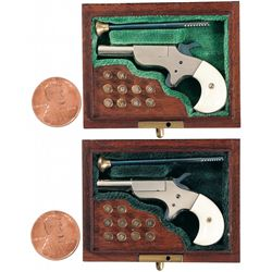 Two Cased Larry Smith Miniature Star Vest Pocket Pistols with Ivory Grips