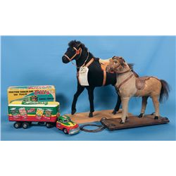 Two Horse Toys and One Toy Truck
