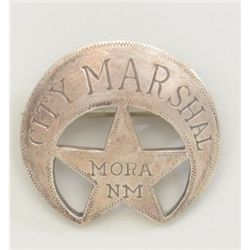 Badge rolled and die pierced and hand  engraved City Marshal Mora NM with clasp  back, collected in