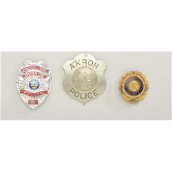 Lot of three authentic public safety badges  in riker case including an old Akron Police  shield (mi