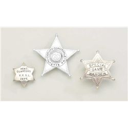 Lot of three old authentic badges in riker  case including a Special Game Warden six  point ball tip