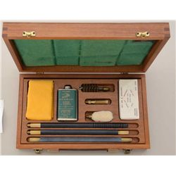 Deluxe shotgun cleaning kit, showing James  Purdey label, unused in original box, for 12  gauge.  Es