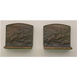 Pair of cast bookends marked solid bronze,  1900-1940s from style, showing cowboys  lassoing steer.
