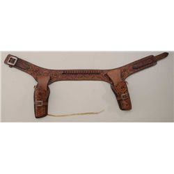"Tooled leather double holster rig with  engraved sterling silver buckle, signed  ""Edward M. Bohlin,"