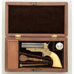 "Cased engraved Sharps four-barrel derringer,  .30 cal., 3"" barrels, brass frame, ivory  grips, seria"