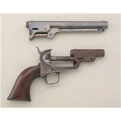 1851 Navy parts, consisting of frame,  backstrap, trigger guard, grips, 2 barrels.   The frame is se