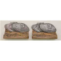 Pair of cast metal bookends, circa WWI,  painted poly-chrome, showing early tanks on  battlefield.